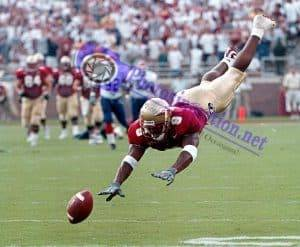 Florida State's Peter Warrick dives for the ball during a game at Doak Campbell Stadium in Tallahassee, FL.