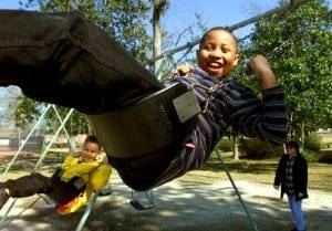 Professional family events photography may include kids playing on a swing enjoying a chilly afternoon